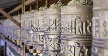 prayer wheels at the buddhist monastery