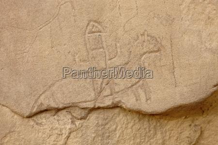 soldier riding a horse petroglyph chetro