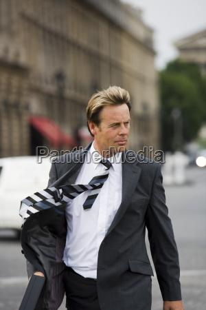 business man crossing road paris france