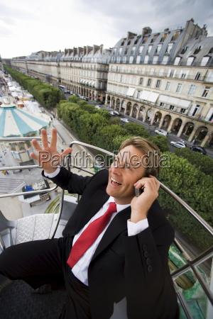 business man on fair ride paris