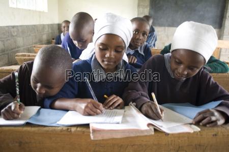 schoolgirls working in a classroom langalanga