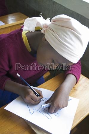 christian schoolgirl working at school ndogo