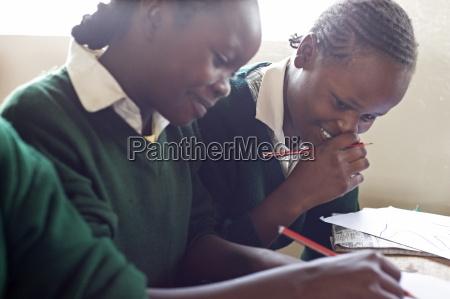 schoolgirls working in class ngumo primary