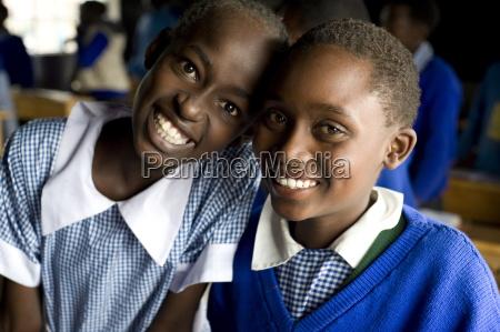 schoolgirls two friends in school uniform