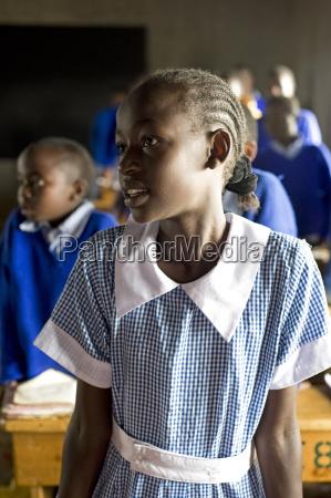 schoolgirl listening to teacher in a