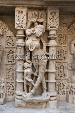 carved dancing girl on wall of