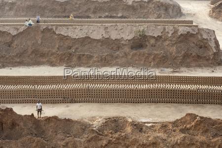 brick workers amongst hand made bricks