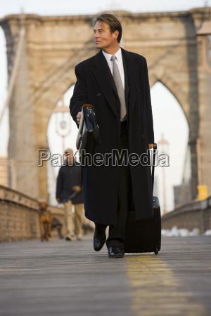 business man brooklyn bridge new york