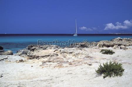 rocks and sailing boat formentera balearic