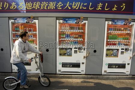 cyclist vending machines shinjuku tokyo honshu