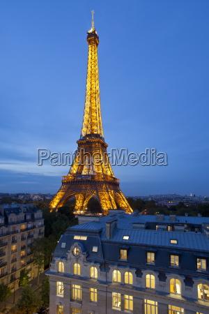eiffel tower viewed over rooftops paris