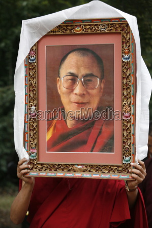 buddhist holding a picture of the
