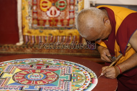 buddhist monk drawing a mandala paris