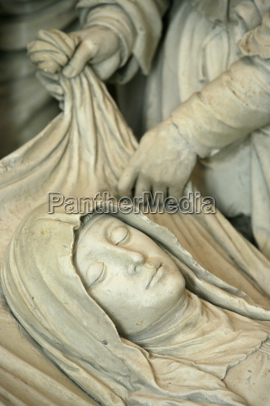 detail of sculpture of marys entombment