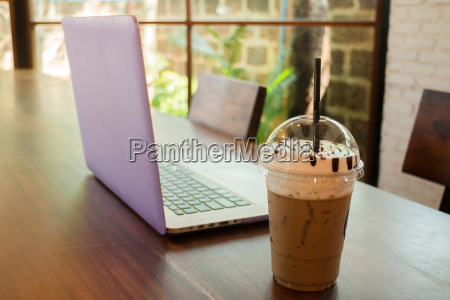 laptop on wooden table at coffee