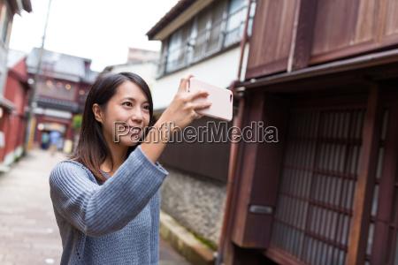 woman travel in kanazawa and taking