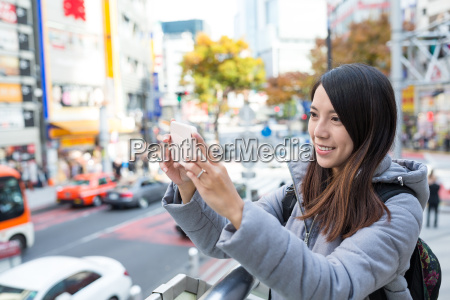 woman taking photo in shibuya of