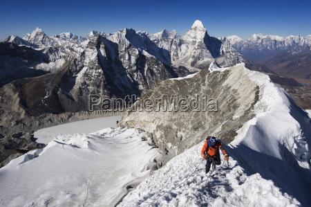 climber on summit ridge of island