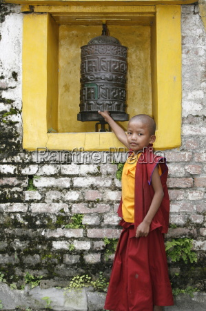 young monk and prayer wheel swayambhunath