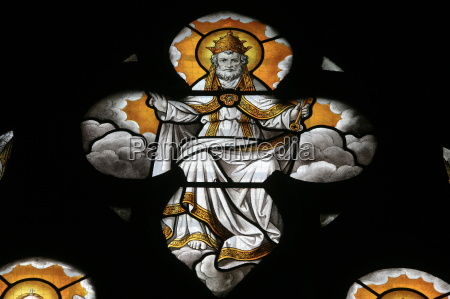 stained glass window depicting god notre