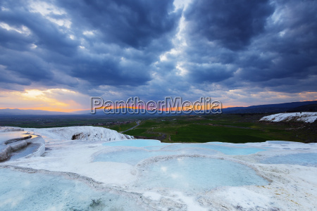 white travertine basins at sunset pamukkale