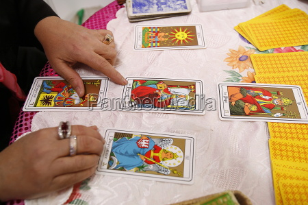 fortuneteller laying cards on the table
