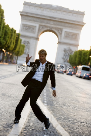man dancing on champs elysees with