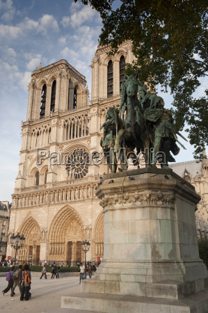 gothic notre dame cathedral and statue