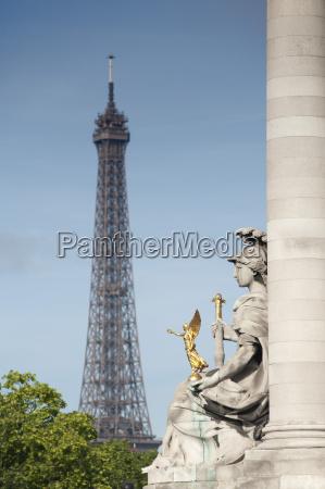 statue on the alexandre iii bridge