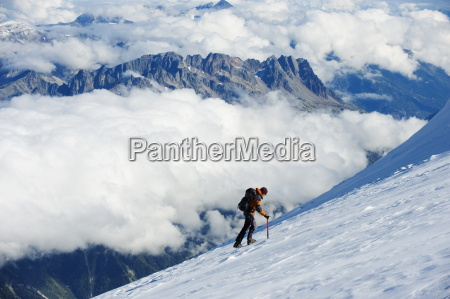 climber on snow field view from