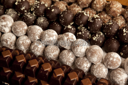 close up of rows of chocolates