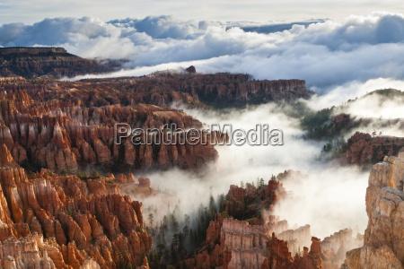 pinnacles and hoodoos with fog extending
