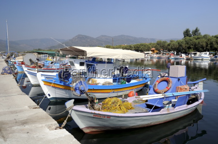 traditional wooden fishing boats moored in