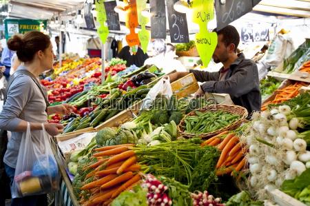 people shopping at market place monge