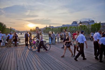 people enjoying the sunset pont des