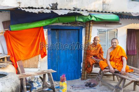 buddhist monks by blue door phnom