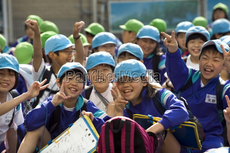 group of smiling japanese elementary school