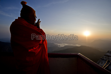 a monk looks out over a