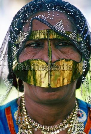 a bedouin woman wearing traditional headgear
