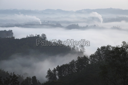 early morning mist and smoke from