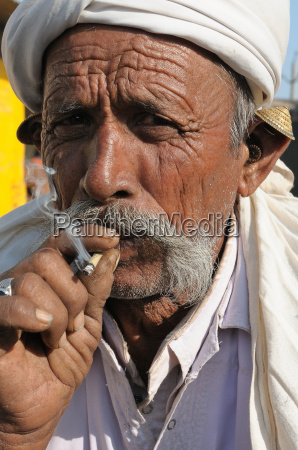 smoking beedies by men in rural
