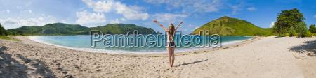 woman enjoying freedom at mawun beach
