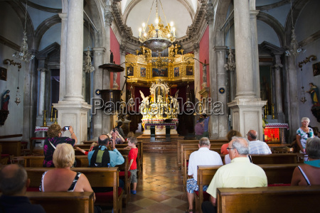tourists inside the church of st
