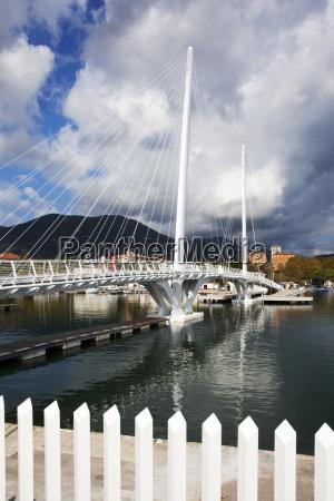 storm clouds over city bridge at