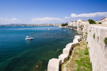 turquoise mediterranean sea and ortigia castle