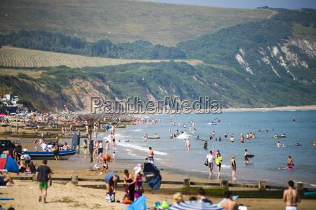 tourists on swanage beach dorset england