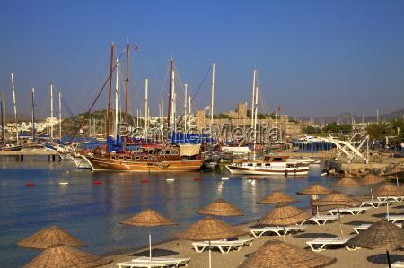 beach boats and castle bodrum anatolia