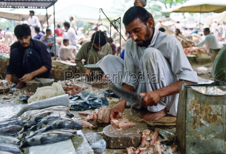 fishmongers gutting fish ready to sell