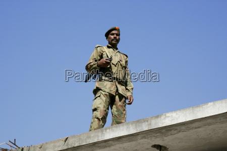 armed pakistani soldier on duty in