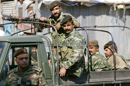 armed pakistani soldiers in open top